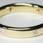 18 carat gold band with diamonds