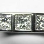 18 carat white gold, 3 princess diamond ring