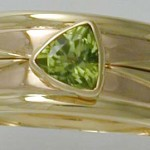 Commissioned 18carat gold peridot engagement & wedding ring