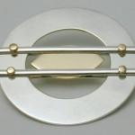 Gold bubble spirit level brooch