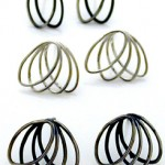 3 pairs of ellipse studs: loops, and fans, plain and oxidised